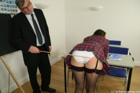 Click to view  A Good Old-Fashioned Caning 3/4